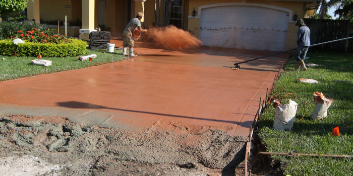 Phase 4 – Color hardeners are applied. Concrete is stamped